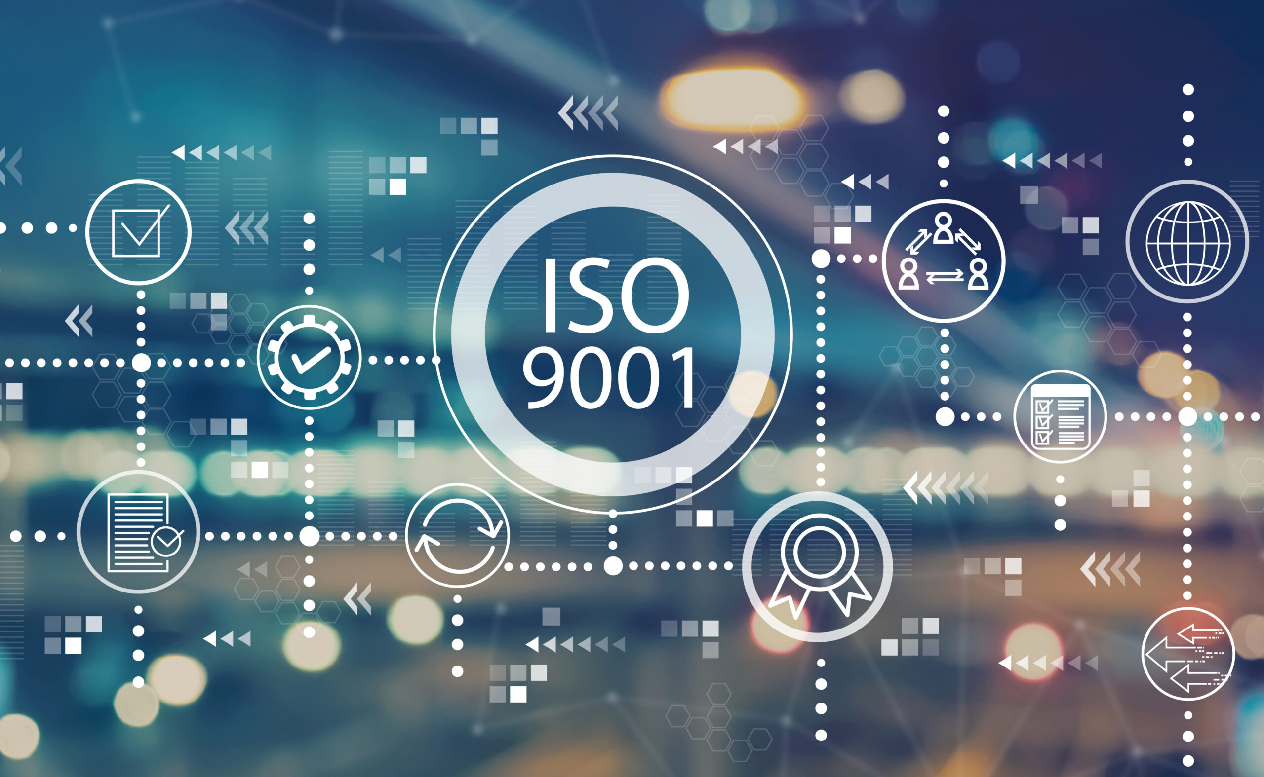 ISO 9001 with blurred city abstract lights background